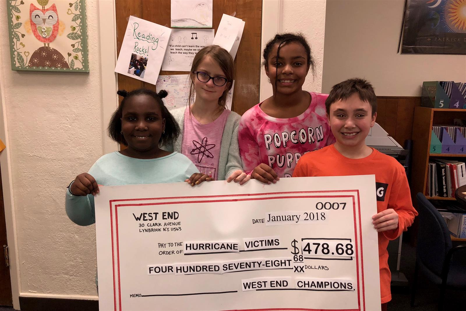 Photo of students with check to hurricane victims